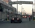 A wheeled vehicle convoy departs Pier 8 at the Port of Pusan, Republic of Korea, Oct. 24, 1998. The vehicles come from the 3rd Brigade, 2nd Infantry Division out of Fort Lewis, Wash - DPLA - 856504eb54f810cef66048bcff31d4b7.jpeg