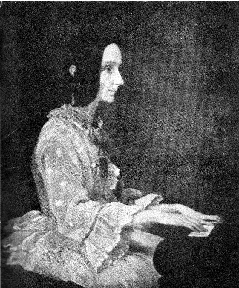 Painting of Ada Lovelace at a piano in 1852 by Henry Phillips. While she was in great pain at the time, she sat for the painting as Phillips' father, Thomas Phillips, had painted Ada's father, Lord Byron.