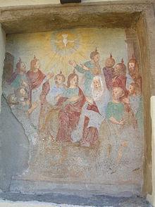 Affresco devozionale su muro esterno, raffigurate il miracolo della Pentecoste a Donnas (Valle d'Aosta)
