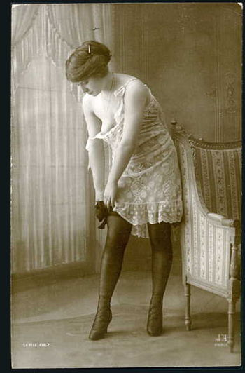 French postcard of woman in early 20th century...
