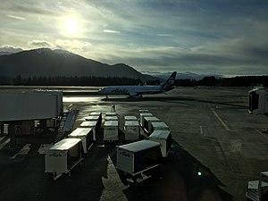 Juneau International Airport - An Alaska Airlines Boeing 737-800 taxiing to the terminal at Juneau International Airport.