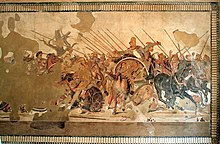 A large mosaic depicting an array of soldiers on horseback doing battle. Parts of it have been damaged or lost to time.