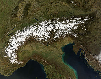 History of the Alps - Satellite photo showing the Alps in winter, at the top of the Italian peninsula.