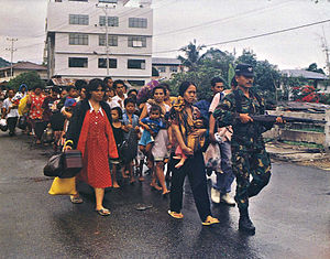Maluku sectarian conflict - Indonesian military forces evacuate refugees from Ambon during the conflict in 1999.