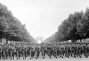 28th Infantry Division (United States) - Men of the 28th Infantry Division marches down the Champs Élysées in Paris, 29 August 1944.