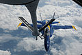 An F-A-18 Hornet aircraft from the U.S. Navy flight demonstration squadron, the Blue Angels, moves into position behind an Air Force KC-135R Stratotanker aircraft from the 157th Air Refueling Wing Aug. 25, 2010 100825-F-UX813-050.jpg
