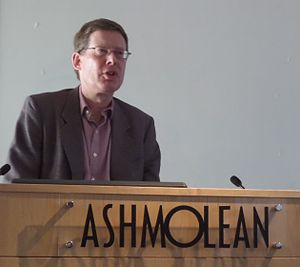 W. Andrew Robinson - Andrew Robinson delivering a talk on the history of India at the Ashmolean Museum, Oxford, in 2014.