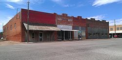 A row of buildings south of the Stonewall County Courthouse in Aspermont, Texas.