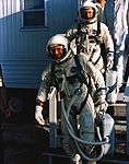 Astronauts L. Gordon Cooper Jr. (foreground) and Charles Conrad Jr. leave suiting trailer at Pad 16.jpg