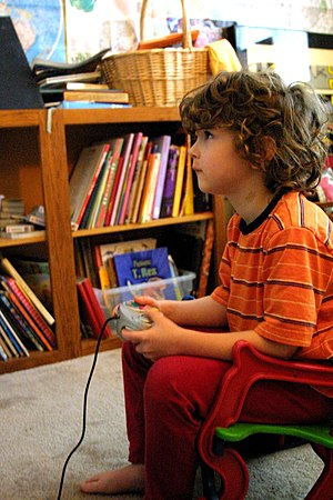 Young person playing with a GameCube