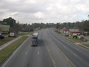 Garden City, Georgia - The 5000 block of the six-lane Augusta Road with George A. Mercer Middle School and Universal Steel Supply on the left and a local Dairy Queen restaurant on the right