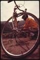 BICYCLIST IN THE MALIBU CANYON AREA NEAR MALIBU, CALIFORNIA WHICH IS LOCATED ON THE NORTHWESTERN EDGE OF LOS ANGELES... - NARA - 557535.tif