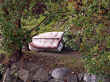 A boat on land next to the waterfront trail on Bainbridge Island.