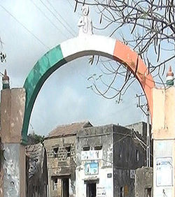 Bakharla Monument: an Indian tricolour painted arch at an entrance to the gham