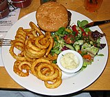 Bar-91 burger, curly fries and salad (cropped).jpg