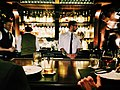 Bartenders serving in a bar (Unsplash).jpg