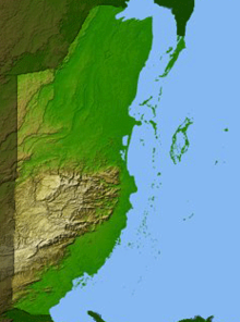 Map showing the topography of then-British Honduras, with shades of green denoting lower elevations and browner, whiter shades showing higher elevations.