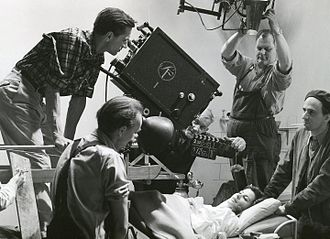 Gunnar Fischer - Fischer (behind the camera), Maj-Britt Nilsson (lying down) and Ingmar Bergman (right) on the set of Secrets of Women, 1952.