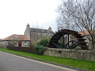 Bonnington, Edinburgh - The old waterwheel at Bonnington Mills with Bonnyhaugh House and the old smiddy behind