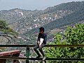 Boy at Bus Stand with Valley View - Shimla - Himachal Pradesh - India (26551432616).jpg