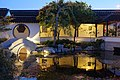 Bridge reflecting in the lake in the evening (Dunedin Chinese Garden).jpg