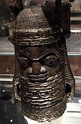 File:British Museum Room 25 Head covered with brass sheeting Carved wood Benin Nigeria 17022019 5154.jpg