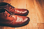 Brown leather boots on a wood floor (Unsplash).jpg