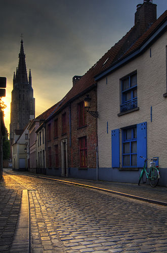 Bruges - An old street in Bruges, with the Church of Our Lady tower in the background