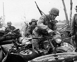 3rd SS Panzer Division Totenkopf - Motorized infantry of the 3rd SS Division Totenkopf on their way to Leningrad, 1941