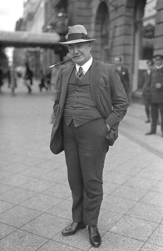 1928 in literature - Edgar Wallace with trademark trilby hat and cigarette holder at the height of his success in 1928