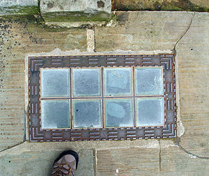 Glass brick - Sidewalk skylight (also named 'pavement light') made of load-bearing glass bricks in Burlington House, London