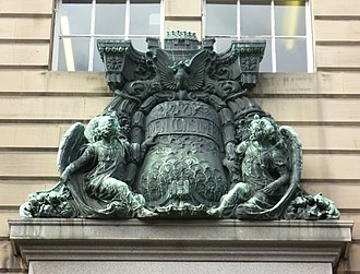 """Church of Scotland offices - Sculpture of the Church's """"Burning Bush"""" emblem above the entrance."""