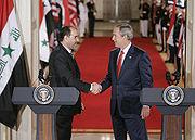 President Bush shakes hands with Iraqi Prime Minister Nouri al-Maliki.