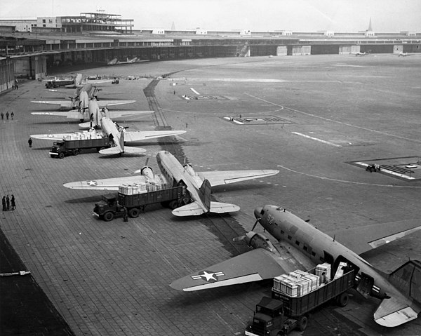 C47s unloading at Tempelhof Airport in Berlin, part of the airlift of supplies which broke the Soviet Union's 1948 land blockade of West Berlin