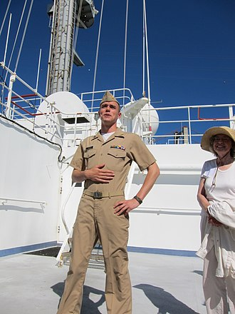 California Maritime Academy Corps of Cadets - A Cadet wearing the Khaki Service Uniform while aboard the Training Ship Golden Bear
