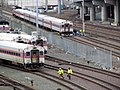 Cab cars and workers at MBTA CRMF, January 2013.JPG