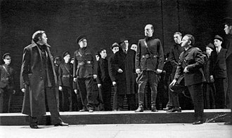 "Caesar (Mercury Theatre) - ""I am constant as the Northern Star"": Caesar (Joseph Holland, standing at center) addresses Brutus (Orson Welles, left) and the conspirators shortly before his assassination in Caesar (1937)"