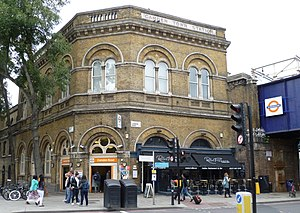 "North London Railway - Camden Road station is one of the few remaining examples of the NLR's yellow-brick, ""Venetian"" architectural style. It was designed by Edwin Henry Horne."