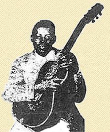 One of the only known photos of Weldon, holding his guitar in his signature Hawaiian style