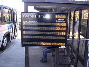 NextBus - Chapel Hill Transit bus stop with NextBus display board, Chapel Hill, North Carolina