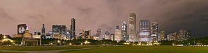 2009–10 Chicago Blackhawks season - Chicago skyline with the CNA Center showing the Chicago Blackhawks' logo, the Smurfit-Stone Building saying Go Hawks and the Blue Cross Blue Shield Tower saying Hawks win the night after the Chicago Blackhawks won the 2010 Stanley Cup Finals, viewed from the Petrillo Music Shell lawn in Grant Park