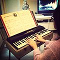 China, playing her new-to-her vintage organ.jpg