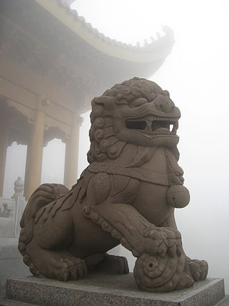 Chinese guardian lions - A statue of a guardian lion looking over Mount Emei, China