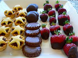 Christmas fare - mince pies, chocolate biscuits and chocolate-dipped strawberries