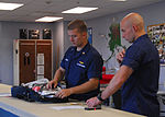 Coast Guard aviation survival technicians prepare emergency medical gear and supplies for missions at Air Station Kodiak, Alaska 140821-G-FO900-055.jpg