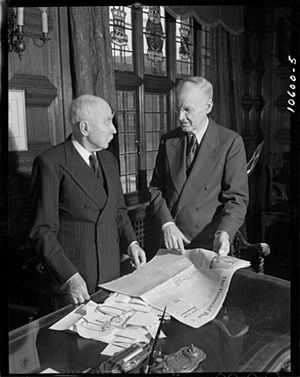 John Bayne Maclean - Lt.Col. J.B. Maclean (left) and Horace Hunter with a copy of The Financial Post, 1947