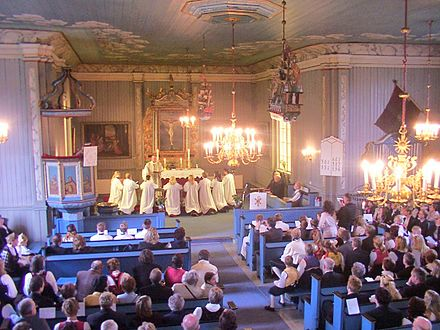 Confirmation in Lunder Church, Ringerike, Norway, 2012. The Church of Norway is a member of the Porvoo Communion, which means that these confirmands would be readily transferred into any Anglican church should they ever emigrate. Confirmation in Lunder Church, Norway.JPG