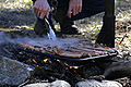 Cooking snags over campfire.jpg