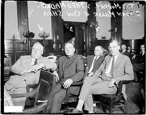 International Brotherhood of Teamsters - Informal portrait of (left to right) Cornelius P. Shea, John Miller, Fred Mader, and Tim Murphy sitting in a row in a courtroom in Chicago, Illinois, during a labor trial. Murphy was a politician, union organizer, and reputed gangster, and he was murdered in 1928.