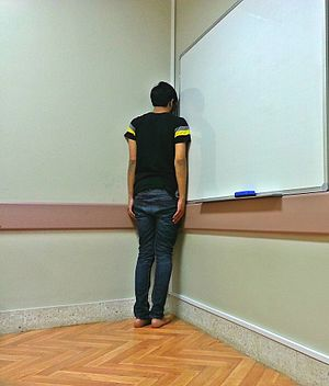 Time-out (parenting) - College student sent to the corner for cheating in a quiz.